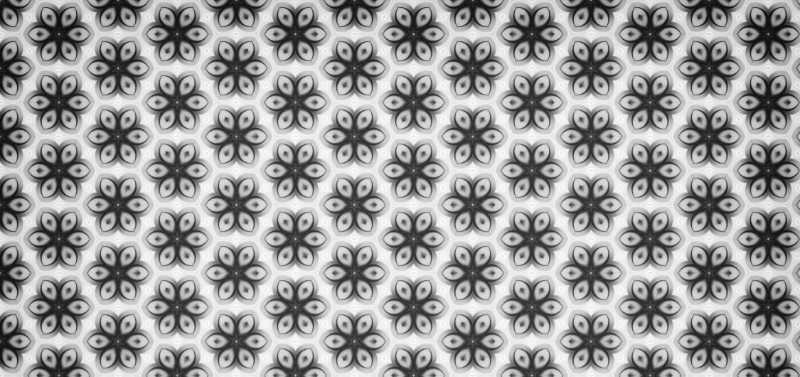 Grafica b/n composta da tanti piccoli fiori. Ogni singolo elemento contribuisce alla comunicazione aziendale ottimale e armonizza l'immagine. Katrin Walter – simply walter